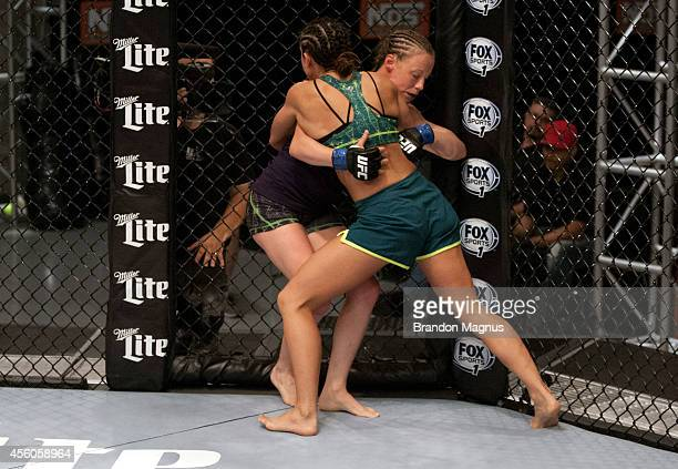 Team Pettis fighter Jessica Penne pushes team Melendez fighter Lisa Ellis up against the fence during filming of season twenty of The Ultimate...