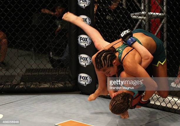 Team Pettis fighter Jessica Penne takes down team Melendez fighter Lisa Ellis during filming of season twenty of The Ultimate Fighter on July 15 2014...