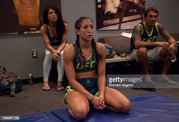 Team Pettis fighter Jessica Penne talks with her teammates after her victory over team Melendez fighter Lisa Ellis during filming of season twenty of...