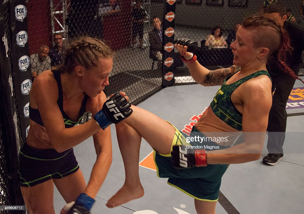 Team Pettis fighter Joanne Calderwood knees team Melendez fighter Rose Namajunas up against the cage in the quarterfinals during filming of season...