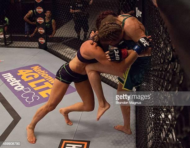 Team Pettis fighter Joanne Calderwood knees team Melendez fighter Rose Namajunas in the quarterfinals during filming of season twenty of The Ultimate...