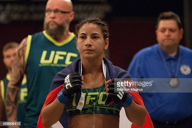 Team Pettis fighter Tecia Torres prepares to enter the Octagon before facing team Pettis fighter Carla Esparza in the quarterfinals during filming of...