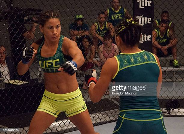 Team Pettis fighter Tecia Torres punches team Pettis fighter Carla Esparza in the quarterfinals during filming of season twenty of The Ultimate...