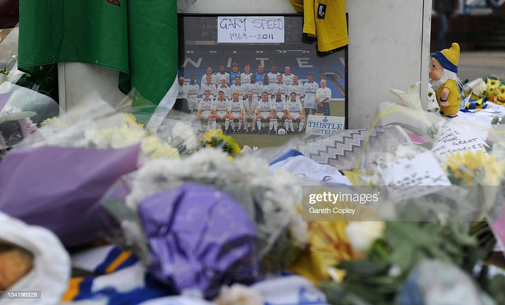 A team photo is left near tributes at the Billy Bremner statue outside Elland Road football ground in memory of former player Leeds United Gary Speed on November 28, 2011 in Leeds, England. Wales Manager Gary Speed, 42, was found dead on November 27, 2011 in Cheshire, England.