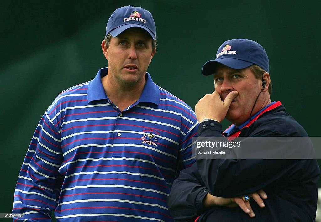 USA team player Phil Mickelson chats with team Captain Hal Sutton on the 11th hole during his morning fourball match with Colin Montgomerie and...