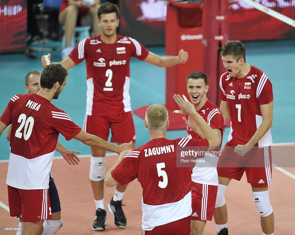 Team Poland celebrate after winning a point during the FIVB World Championships match between Australia and Poland on September 2, 2014 in Wroclaw, Poland.