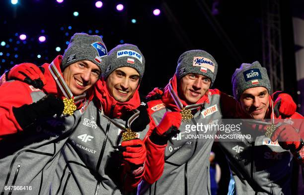 Team Poland celebrate during the medals ceremony after the Men's Large Hill Team Ski Jumping event of the 2017 FIS Nordic World Ski Championships in...