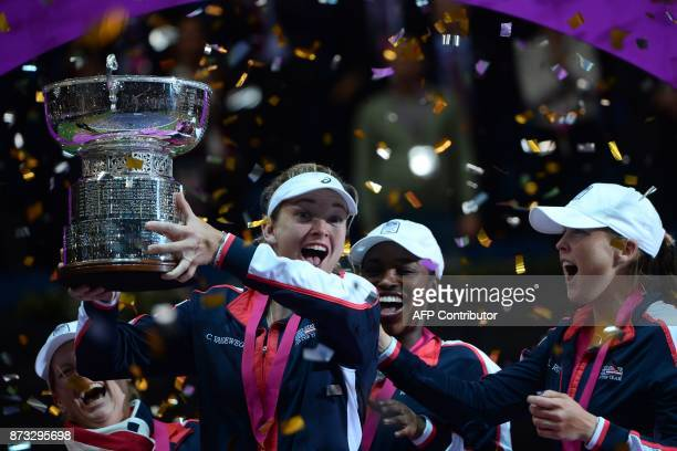 TOPSHOT US team pose with their trophy after the Fed Cup final tennis match between Belarus and the United States in Minsk on November 12 2017 / AFP...