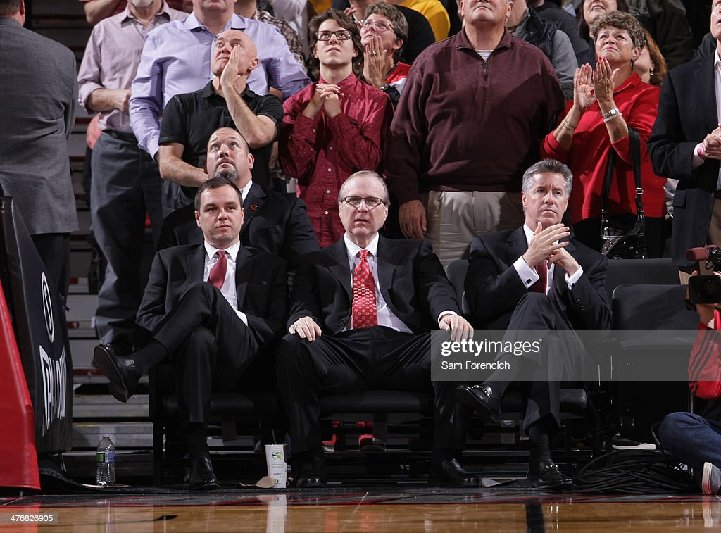 Team President Chris McGowan, owner Paul Allen, and General Manager Neil Olshey of the Portland Trail Blazers enjoy the game on March 3, 2014 at the Moda Center Arena in Portland, Oregon.