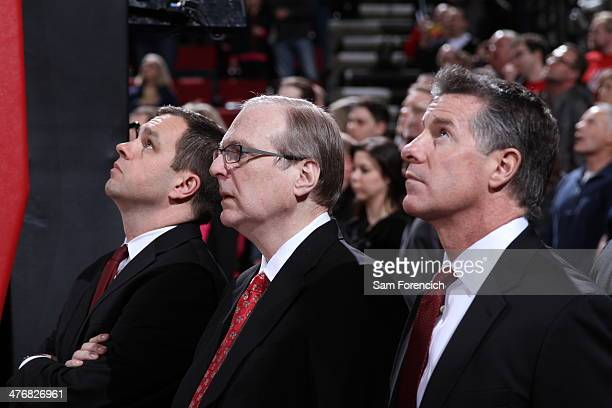 Team President Chris McGowan owner Paul Allen and General Manager Neil Olshey of the Portland Trail Blazers stand during player introductions on...