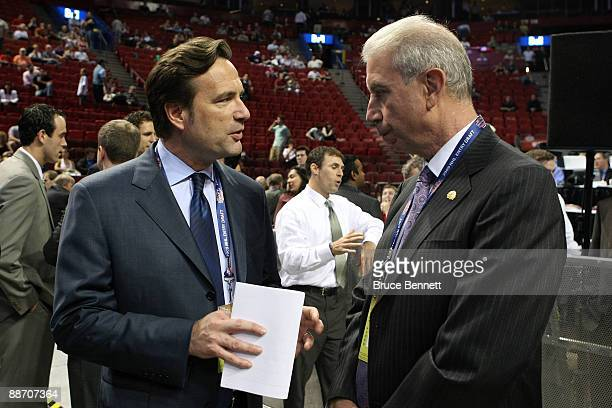 Team President John F McDonough of the Chicago Blackhawks talks with NHL Chief Operating Officer John Collins prior to the first round of the 2009...