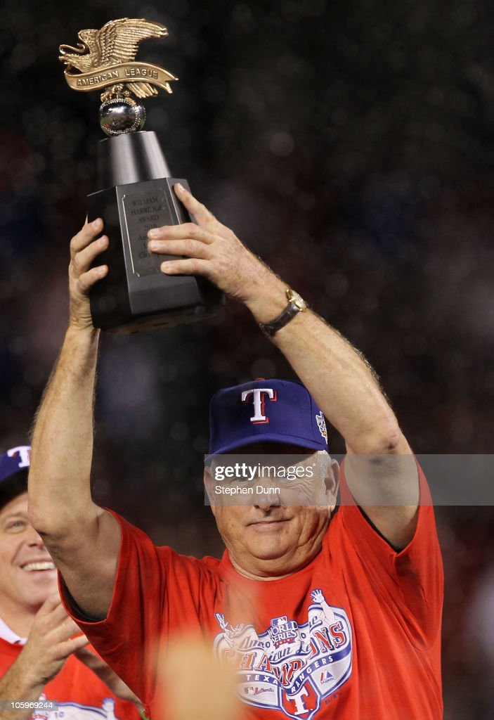 Team president <a gi-track='captionPersonalityLinkClicked' href=/galleries/search?phrase=Nolan+Ryan&family=editorial&specificpeople=202212 ng-click='$event.stopPropagation()'>Nolan Ryan</a> of the Texas Rangers holds the Warren C. Giles Trophy after defeating the New York Yankees in Game Six of the ALCS to advance to the World Series during the 2010 MLB Playoffs at Rangers Ballpark in Arlington on October 22, 2010 in Arlington, Texas.