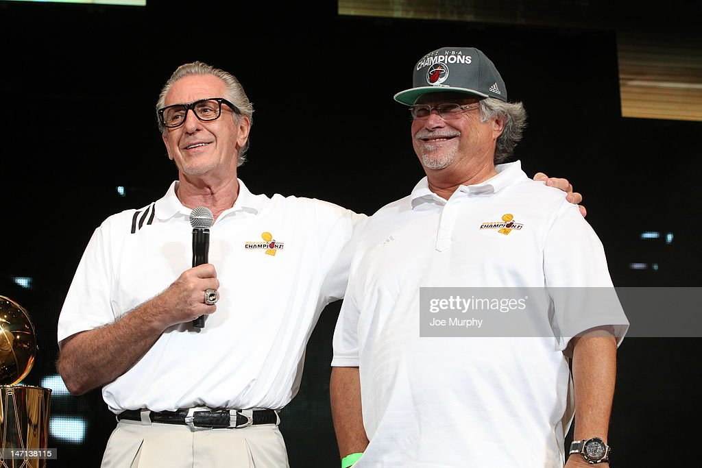 Team President Pat Riley and Miami Heat Owner Micky Arison talk to the crowd during a rally for the 2012 NBA Champions Miami Heat on June 25, 2012 at American Airlines Arena in Miami, Florida.