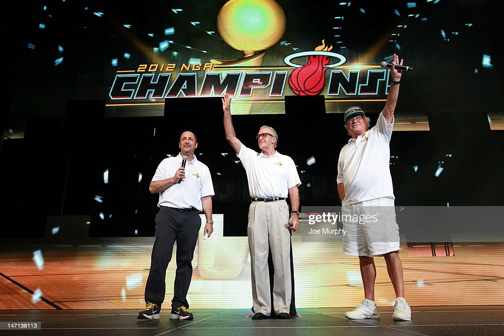 Team President Pat Riley and Miami Heat Owner Micky Arison wave to the crowd during a rally for the 2012 NBA Champions Miami Heat on June 25, 2012 at American Airlines Arena in Miami, Florida.