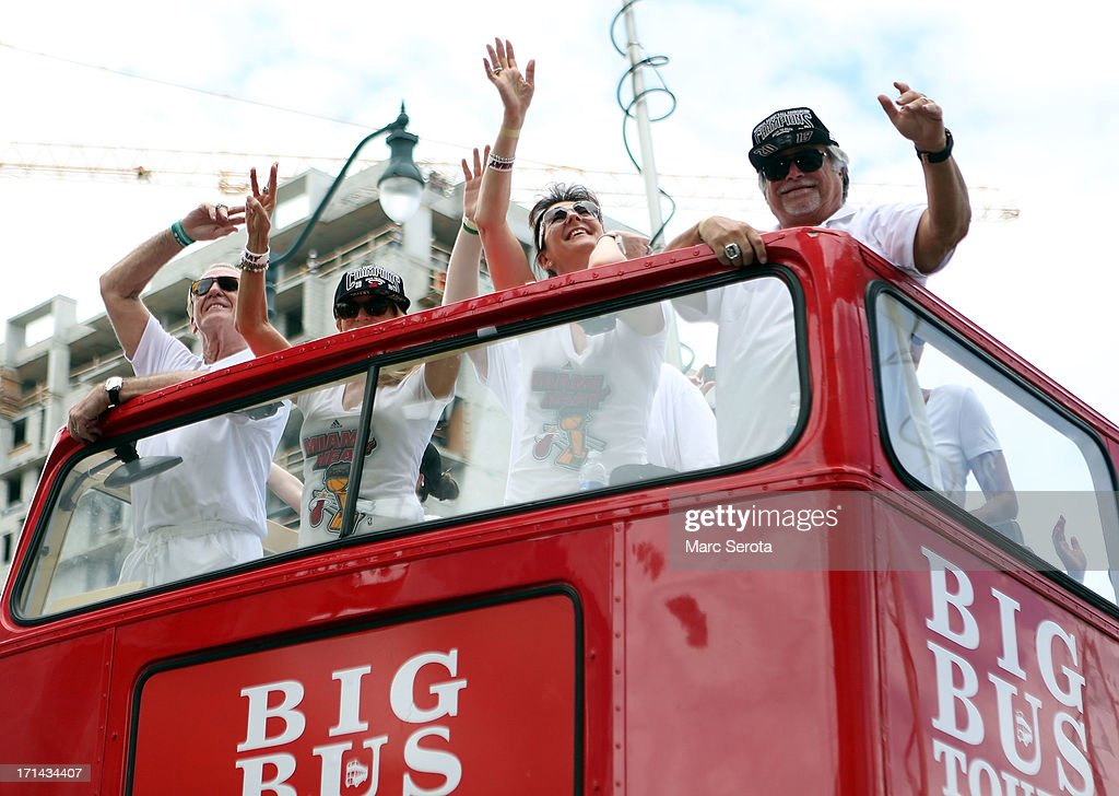 Team President Pat Riley and Owner Micky Arison of the Miami Heat ride a bus during the NBA championship victory parade on June 24 2013 in Miami...