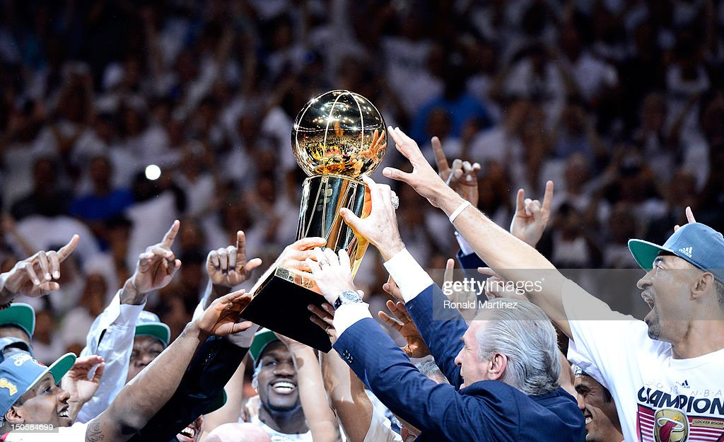 Team President Pat Riley and the Miami Heat players celebrate with the Larry O'Brien Championship trophy after they won 121-106 against the Oklahoma City Thunder in Game Five of the 2012 NBA Finals on June 21, 2012 at American Airlines Arena in Miami, Florida.