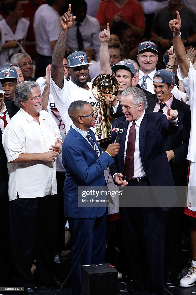Team President Pat Riley of the Miami Heat is interviewed by Stuart Scott as head coach Erik Spoelstra, LeBron James #6 and team owner Micky Arison in Game Five of the 2012 NBA Finals on June 21, 2012 at American Airlines Arena in Miami, Florida.