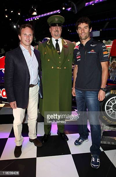 Team Principal Christian Horner a Harrods employee and Red Bull Racing Driver Mark Webber attend a photocall for the super breathable Geox racing...