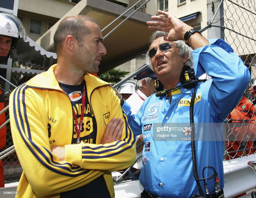 Team principal Flavio Briatore (R) of Renault chat on the start grid with football player Zinedine Zidane of France and Real Madrid before the Monaco Formula One Grand Prix on May 22, 2005 in Monte Carlo, Monaco.