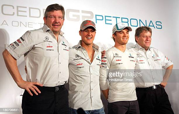 Team Principal Ross Brawn and drivers Michael Schumacher and Nico Rosberg of Mercedes GP pose along with Vice President Mercedes Motorsport Norbert...