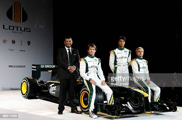 Team Principal Tony Fernandes Jarno Trulli of Italy Fairuz Fauzy of Malaysian Heikki Kovalainen of Finland pose with the new Lotus T127 F1 car during...