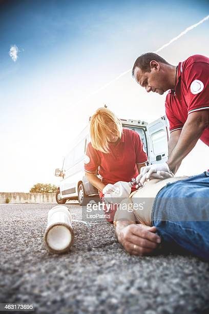 EMT team provide first aid on the street