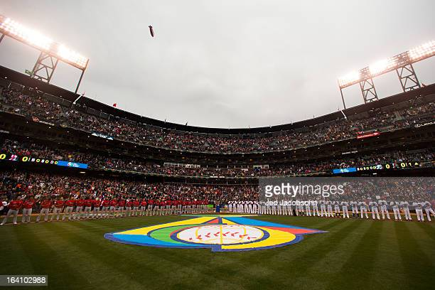 Team Puerto Rico and Team Dominican Republic players and coaches are seen on the field during the pregame ceremony before the 2013 World Baseball...
