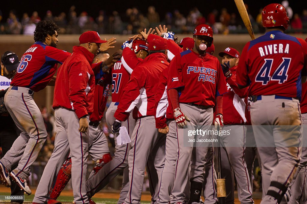 Team Puerto Rico celebrates after Alex Rios #51 hit a two-run home run in the top of the seventh inning of the semi-final game against Team Japan in the championship round of the 2013 World Baseball Classic on Sunday, March 17, 2013 at AT&T Park in San Francisco, California.
