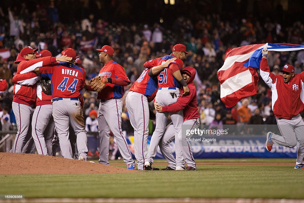 Team Puerto Rico celebrates after defeating Japan in the semi-final game against Team Japan in the championship round of the 2013 World Baseball Classic on Sunday, March 17, 2013 at AT&T Park in San Francisco, California.