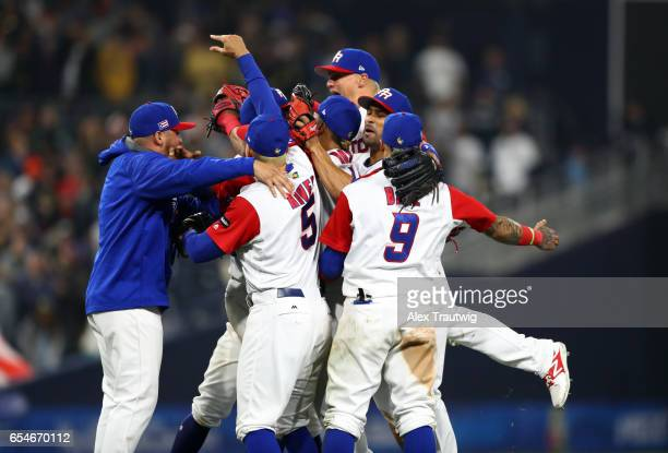 Team Puerto Rico celebrates after the final out of Game 4 of Pool F of the 2017 World Baseball Classic against Team USA on Friday March 17 2017 at...