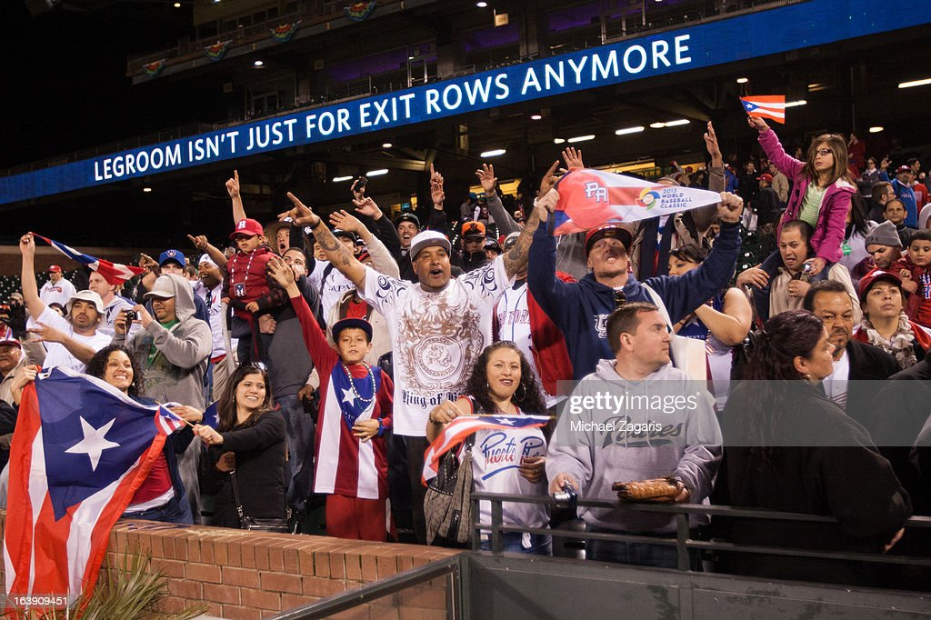 Team Puerto Rico fans celebrate in the stands after the semi-final game against Team Japan in the championship round of the 2013 World Baseball Classic on Sunday, March 17, 2013 at AT&T Park in San Francisco, California. Puerto Rico defeated Japan 3-1.