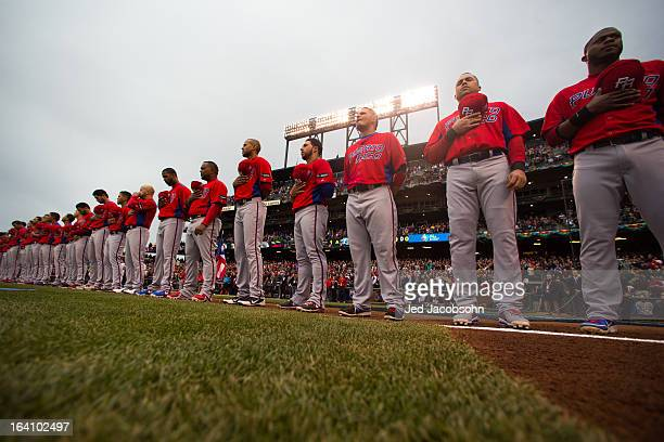 Team Puerto Rico players line up during the National Anthem before the 2013 World Baseball Classic Championship Game against Team Dominican Republic...