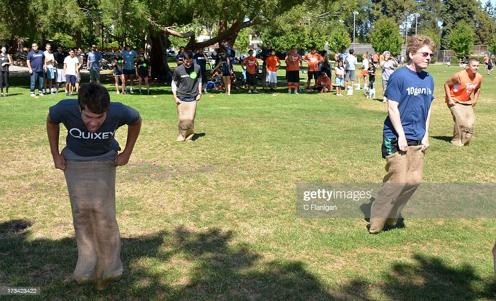 Team Quixey, DFJ, 10GEN and Tango members participate in the Burlap Sack Race during the Founder Institute's Silicon Valley Sports League event on July 13, 2013 in Palo Alto, California.