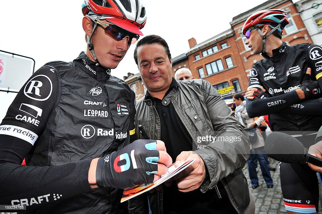 Team Radioshack Luxembourg's cyclist Andy Schleck signs autographs before the start of the 3rd edition of the Binche-Tournai-Binche Memorial Frank Vandenbroucke one day cycling race on October 2, 2012 in Binche. **Belgium Out**