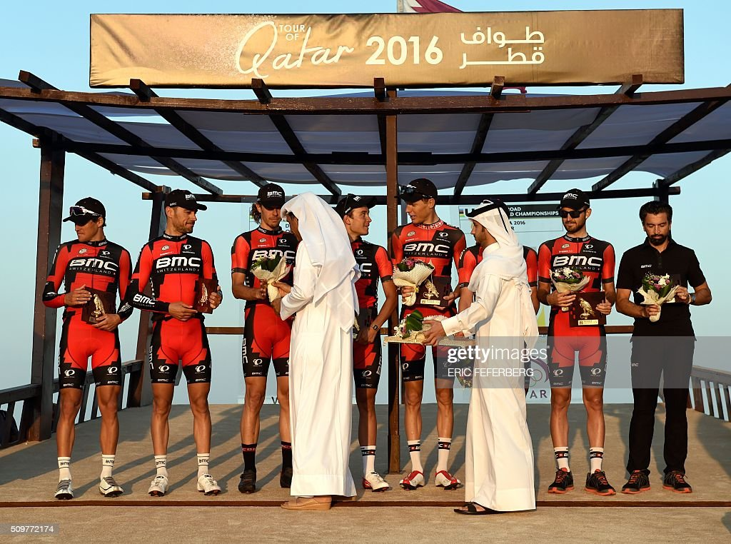 BMC team receives the trophy of the best team during the victory ceremony following the 5th and final stage of the 15th Tour of Qatar, between Sealine Beach Resort and Doha Corniche, on February 12, 2016, in Qatar. / AFP / ERIC FEFERBERG