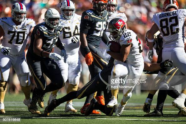 Team Rice running back Doug Martin of the Tampa Bay Buccaneers carries the ball against Team Irvin during the first half of the 2016 Pro Bowl at...