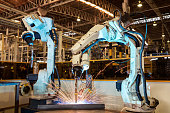 Team robot are welding assembly automotive part in factory