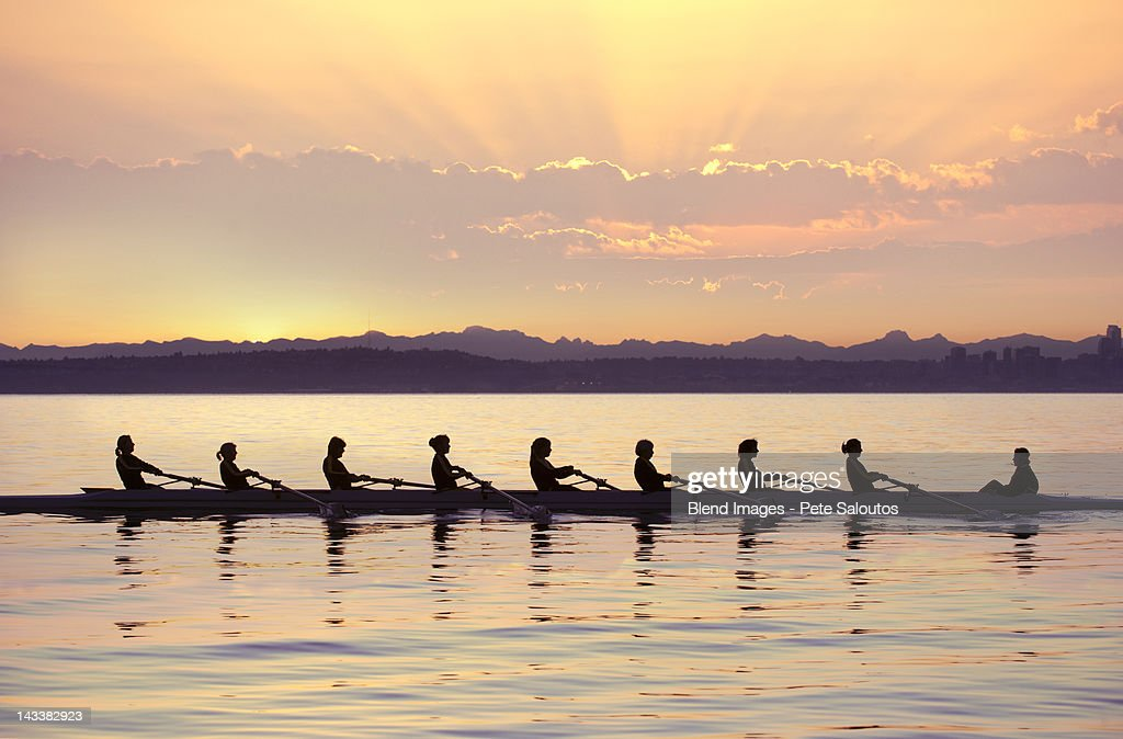 Team Rowing Boat In Bay Stock Photo | Getty Images