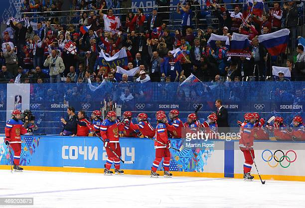 Team Russia celebrate after a goal against Sweden in the first period during the Women's Ice Hockey Preliminary Round Group B game on day six of the...
