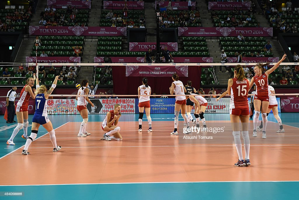 Team Russia celebrate after winning the match against China during the FIVB World Grand Prix Final group one match between Russia and China on August 24, 2014 in Tokyo, Japan.