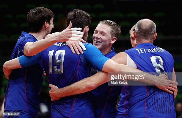 Team Russia celebrates after a point during the Men's Bronze Medal Match between United States and Russia on Day 16 of the Rio 2016 Olympic Games at...