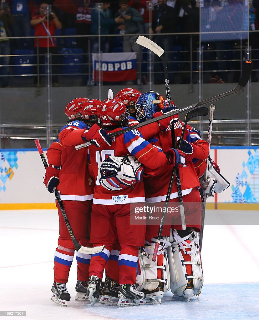 Team Russia celebrates on the ice after defeating Sweden 3-1 during the Women's Ice Hockey Preliminary Round Group B game on day six of the Sochi 2014 Winter Olympics at Shayba Arena on February 13, 2014 in Sochi, Russia.