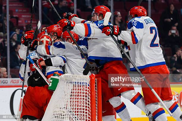Team Russia celebrates their victory over Team United States in a quarterfinal round during the 2015 IIHF World Junior Hockey Championships at the...