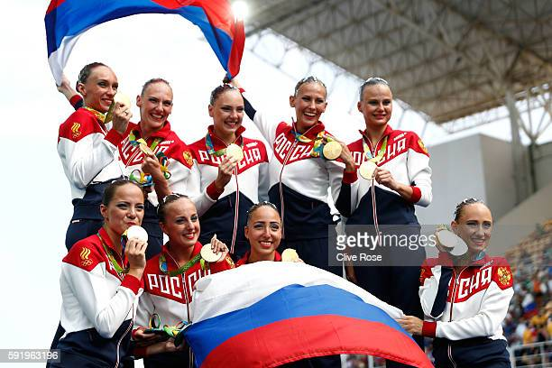 Team Russia celebrates winning gold on the podium during the medal ceremony for the Synchronised Swimming Teams Free Routine on Day 14 of the Rio...