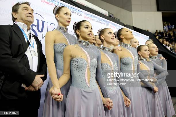 Team Russia Paradise waits in the kiss cry for their results after skating in the free skate during the ISU Wolrd Figure Skating Championships on...