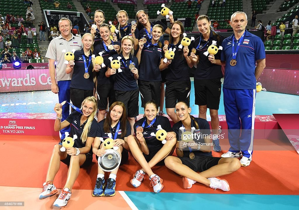 Team Russia pose for photo with bronze medal during the FIVB World Grand Prix Final group one match between Brazil and Japan on August 24, 2014 in Tokyo, Japan.