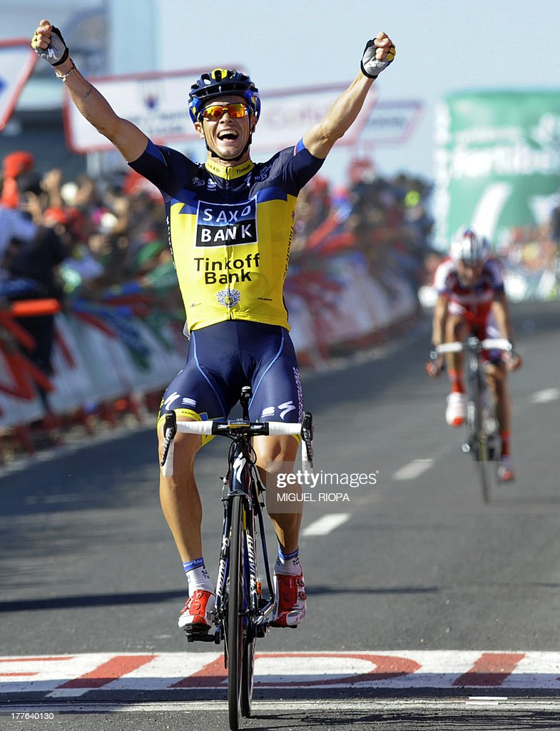 Team Saxo - Tinkoff's Irish rider Nicolas Roche celebrates his victory at the end of the second day of the 68th edition of 'La Vuelta' Tour of Spain, a 177,7km stage between Baiona and Alto do Monte da Groba, on August 25, 2013.