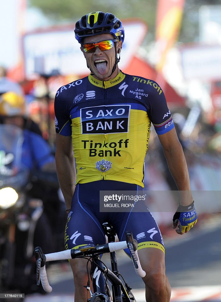 Team Saxo - Tinkoff's Irish rider Nicolas Roche sticks out his tongue as he celebrates his victory at the end of the second day of the 68th edition of 'La Vuelta' Tour of Spain, a 177,7km stage between Baiona and Alto do Monte da Groba, on August 25, 2013. AFP PHOTO/ MIGUEL RIOPA