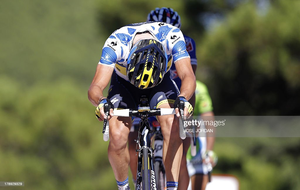 Team Saxo-Tinkoff's Irish rider Nicolas Roche reacts as he crosses the finish line on the eighth day of the 68th edition of 'La Vuelta' Tour of Spain, a 205,9km stage between Jerez de la Frontera and Alto de Penas Blancas, on August 31, 2013.