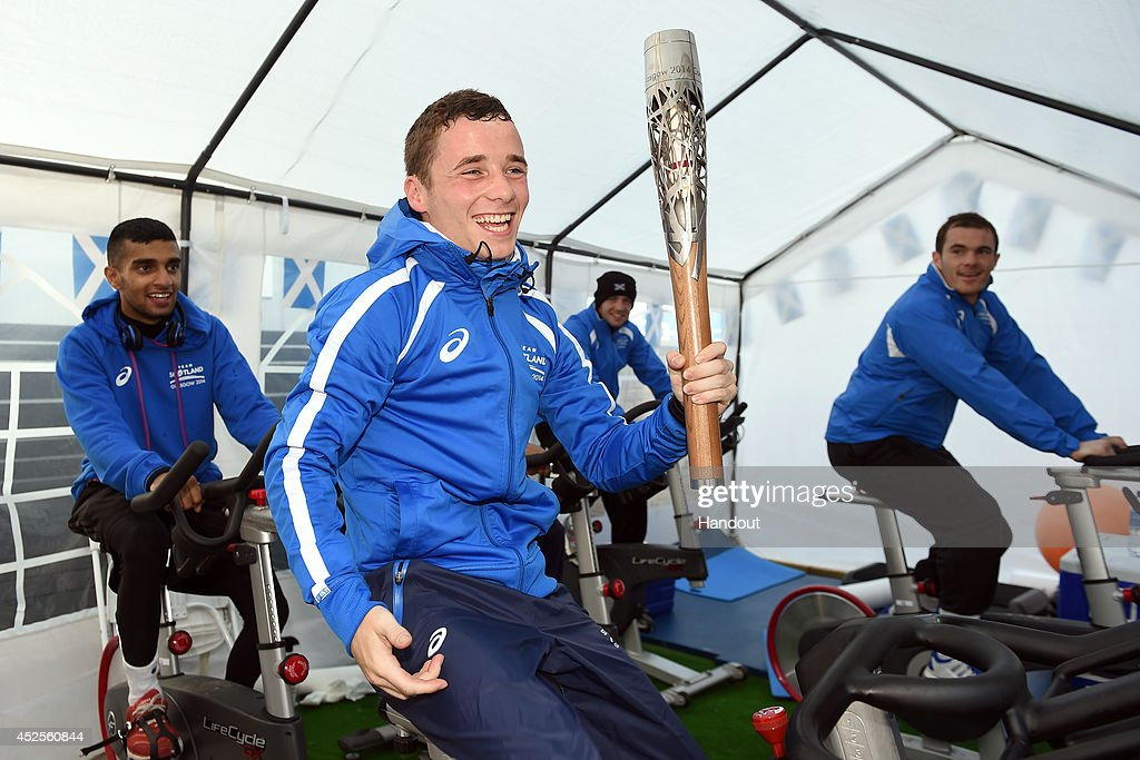 Team Scotland boxer Reece McFadden holds the Glasgow 2014 Queen's Baton as he tries to make weight for competition at the Commonwealth Games Athletes' Village on July 23, 2014 in Glasgow, Scotland. Scotland is nation 70 of 70 nations and territories the Queen's Baton will visit.
